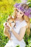 Teenager girl is holding her dog Stock Image