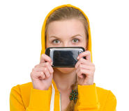 Teenager girl holding mobile in front of face Royalty Free Stock Photography