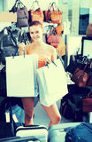 Teenager girl holding shopping bags in boutique Stock Photography