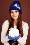 Teenager girl is holding snowball Stock Images
