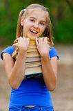 Teenager girl holding stack Stock Photography