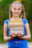 Teenager girl holding stack Royalty Free Stock Image