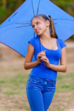 Teenager girl holding umbrellas Royalty Free Stock Photos
