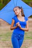 Teenager girl holding umbrellas Royalty Free Stock Photos