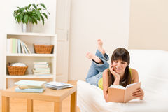 Teenager girl home - student read book Royalty Free Stock Images