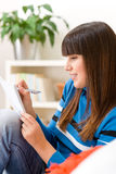 Teenager girl home - student write homework Royalty Free Stock Photos