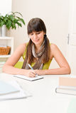 Teenager girl home - student write homework Royalty Free Stock Image