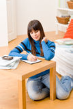 Teenager girl home - student write homework Stock Image