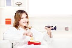 Teenager girl at home watching television Stock Photo