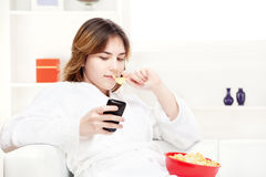 Teenager girl at home writing message on phone Stock Photo