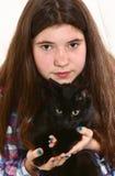 Teenager girl hug black cat Royalty Free Stock Photos