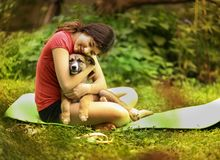Teenager girl hug puppy shepherd dog close up photo. On green garden background Royalty Free Stock Image