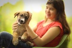 Teenager girl hug puppy shepherd dog close up photo Stock Image