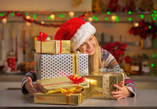 Teenager girl hugging christmas present boxes Royalty Free Stock Photography
