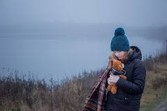 Free Teenager  Girl Hugging  Teddy Bear By Foggy  Lake.  Concept Of Adolescence And Adolescent Problems Stock Photography - 167422082