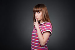 Teenager girl hushing Royalty Free Stock Photo