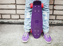 Teenager girl in jeans  holds a skateboard Royalty Free Stock Photos