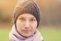 Teenager girl in knitted hat outdoor portrait Stock Photo