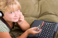 Teenager girl with laptop and Royalty Free Stock Photo