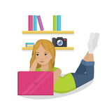 Teenager girl laying in her room with pink laptop Stock Photos