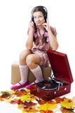 Teenager girl listen music with gramophone Stock Photos