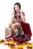 Teenager girl listen music with gramophone Stock Photos