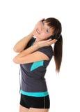 Teenager girl is listen music on headphones Stock Images