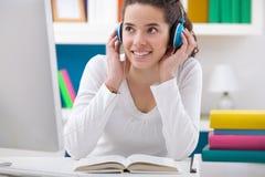 Teenager girl listening music Stock Photo