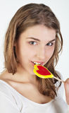Teenager girl with lollipop Stock Photo