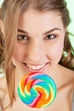 Teenager girl with lollipop Stock Images