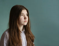 Teenager girl with long brown hair sad portrait Stock Photography