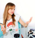 Teenager girl looking on painted nails square Stock Image