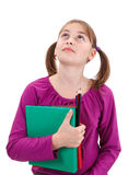 Teenager girl looking up. Holding maps and pencils in her hand Stock Images