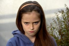 Grumpy teenage girl Stock Images