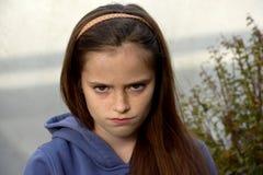 Grumpy teenage girl stock images