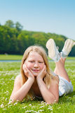 Teenager girl lying on the grass Stock Photo