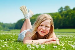Teenager girl lying on the grass Stock Images
