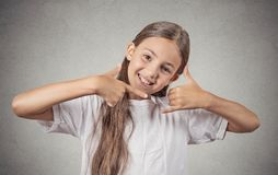 Teenager  girl making call me gesture sign Stock Image