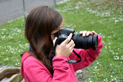 Teenager girl making a photo Royalty Free Stock Photography