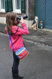Teenager girl making a photo Stock Images