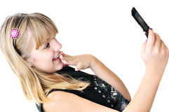 Teenager girl with mobile phone Stock Images