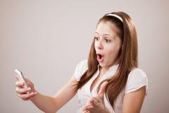 Teenager girl and mobile phone Stock Photo