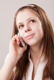 Teenager girl and mobile phone Stock Photos