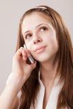 Teenager girl and mobile phone Stock Photos