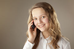 Teenager girl and mobile phone Royalty Free Stock Photography