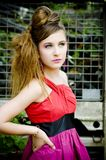 Teenager girl model presenting clothes Stock Photos
