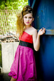 Teenager girl model presenting clothes Royalty Free Stock Photos