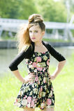 Teenager Girl Model Presenting Clothes In The Park Stock Image