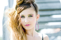 Teenager girl model presenting clothes in the park Royalty Free Stock Photo