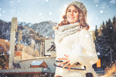 Teenager girl opposite of ice skating rink, outdoor. Winter activities royalty free stock images